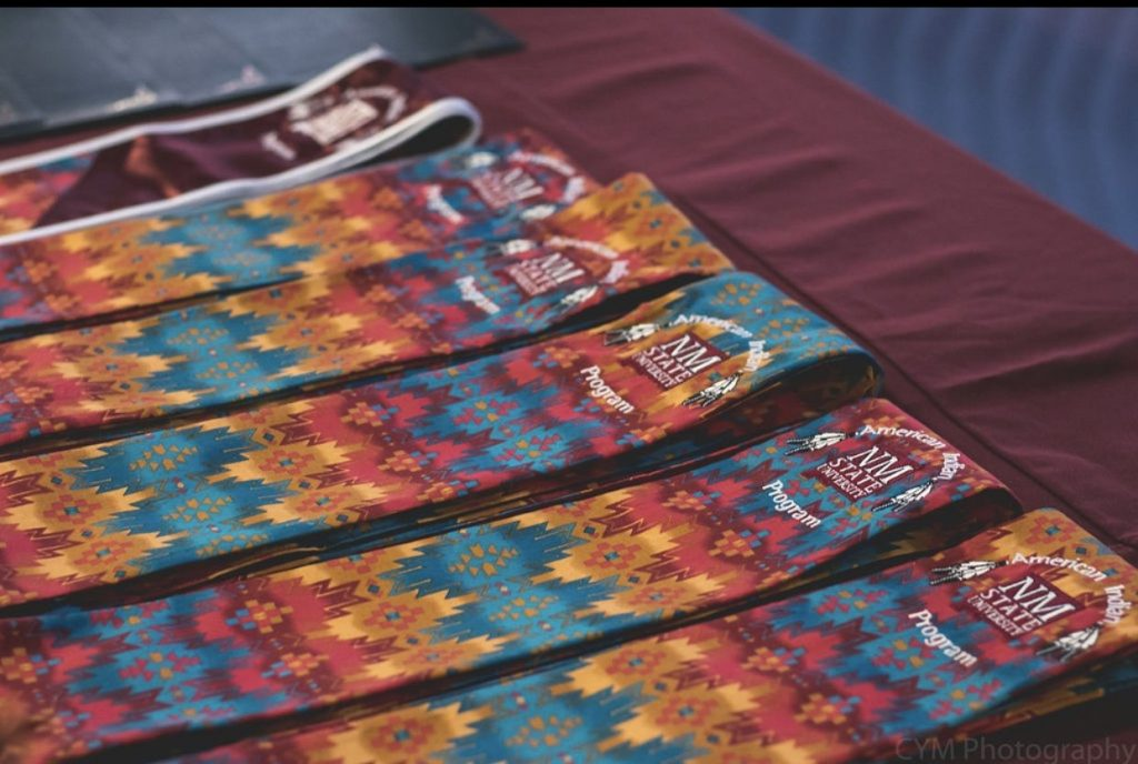 American Indian Stoles on table with crimson table cloth